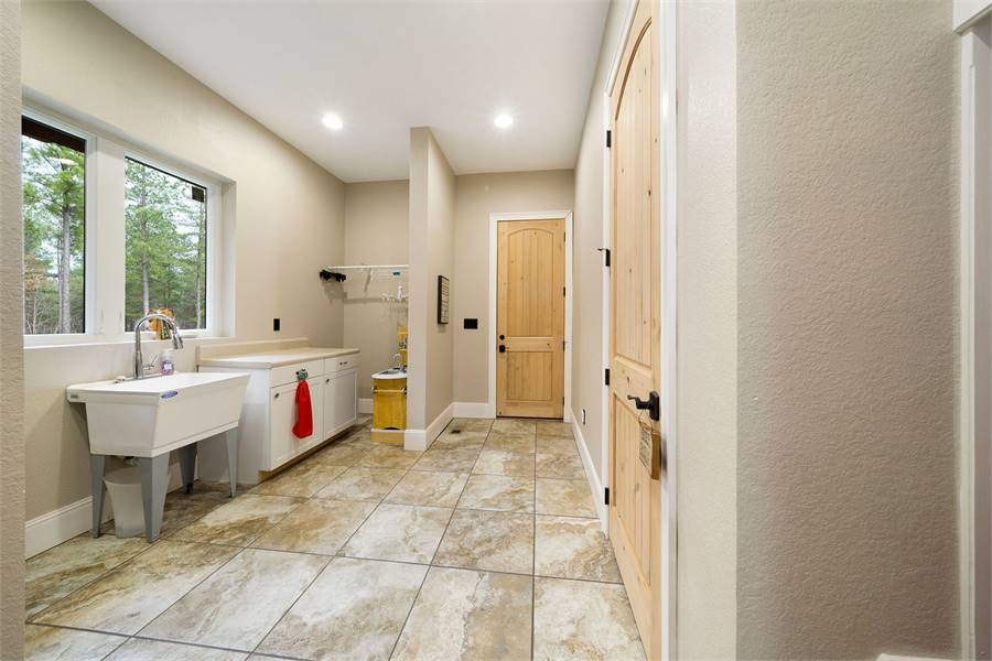 Laundry Room Featuring Maytag® and Brizo®