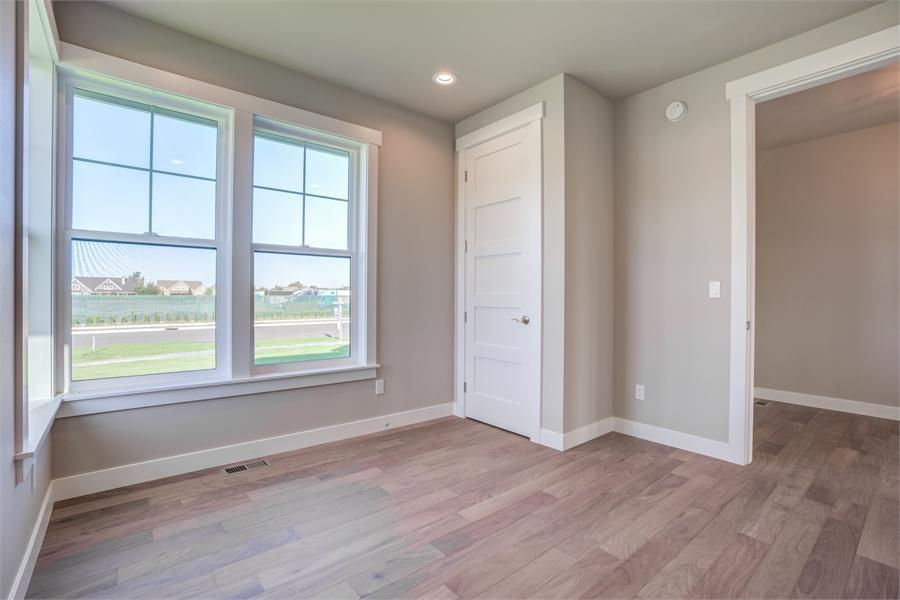 Den image of Cont. Farmhouse 819 House Plan